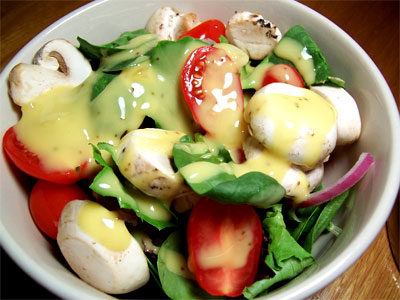 Salad with spinach, lettuce, mushrooms, grape tomatoes, red onions, and vidalia onion vinaigrette.
