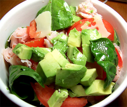 Spinach Salad with Avocado, Turkey, Swiss Cheese, and Tomatoes